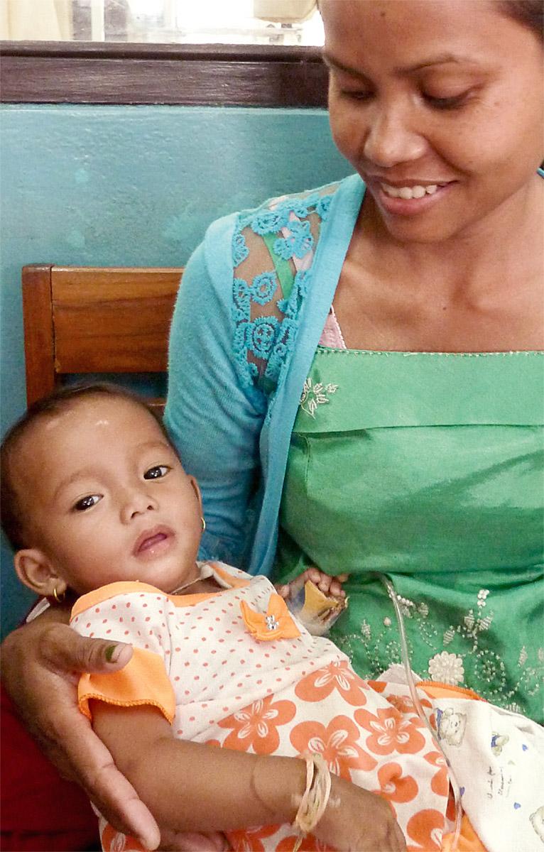Mutter mit Kind in Laos