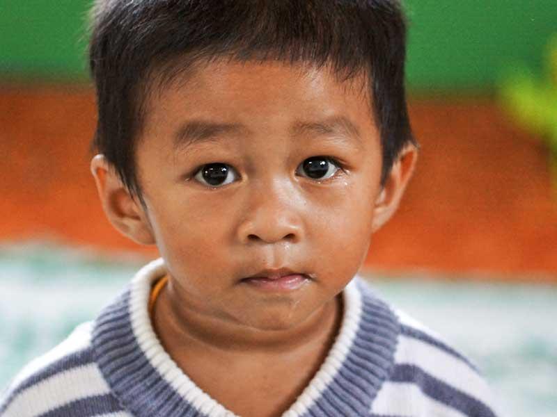 Junge in Laos